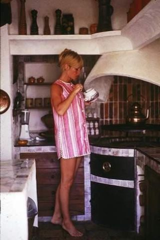 Brigitte in her Kitchenette.